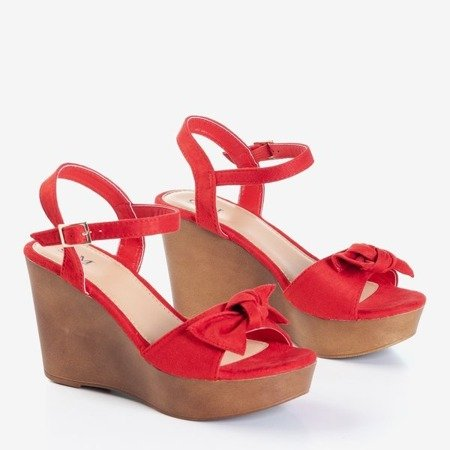 Красные сандалии на танкетке с декоративным бантом Doria - Обувь
