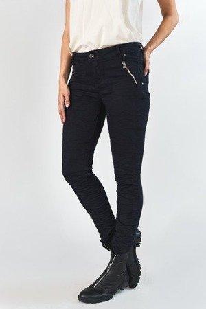 Жіночі чорні джинсові штани з рюшами - Одяг