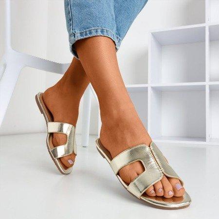 Золоті жіночі шльопанці з металевою обробкою Hemilda - Взуття 1