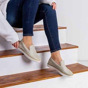 OUTLET Золоті жіночі кросівки сліп на Leokadia - Взуття